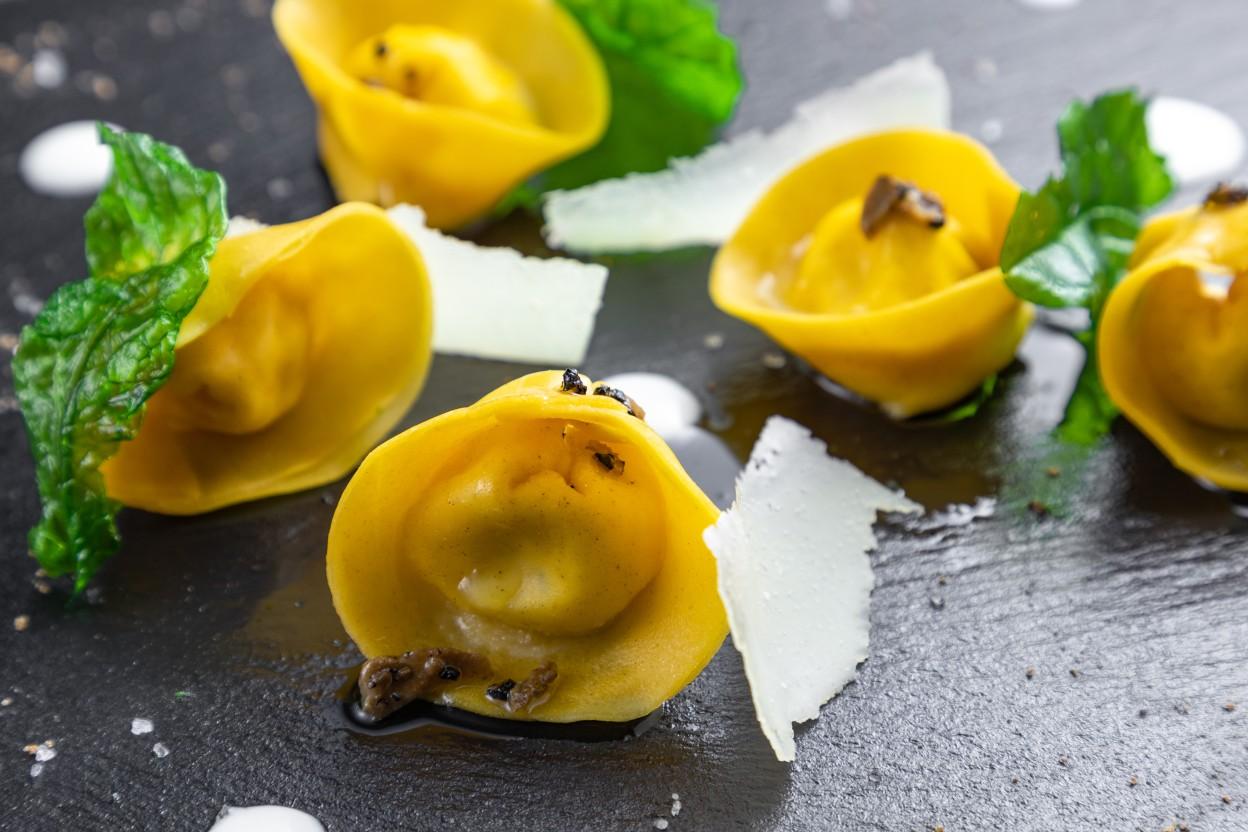 Ricotta and truffle filled tortellini, potato cream, organic rocket