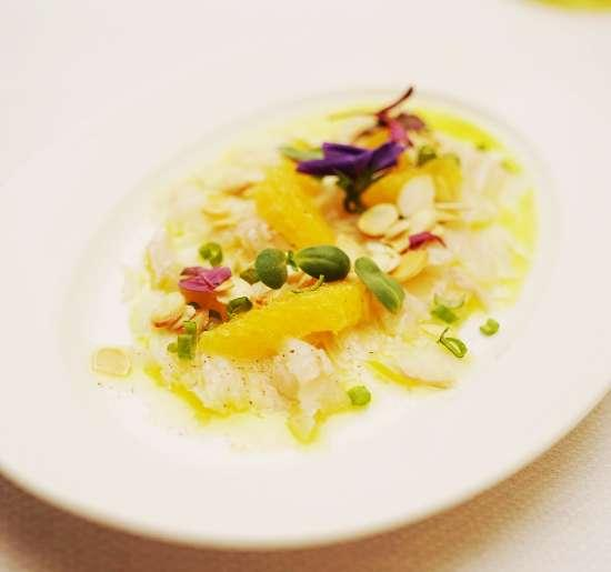 Italian style Seabass Carpaccio,Orange, Spring onion, Toasted Almond Flakes